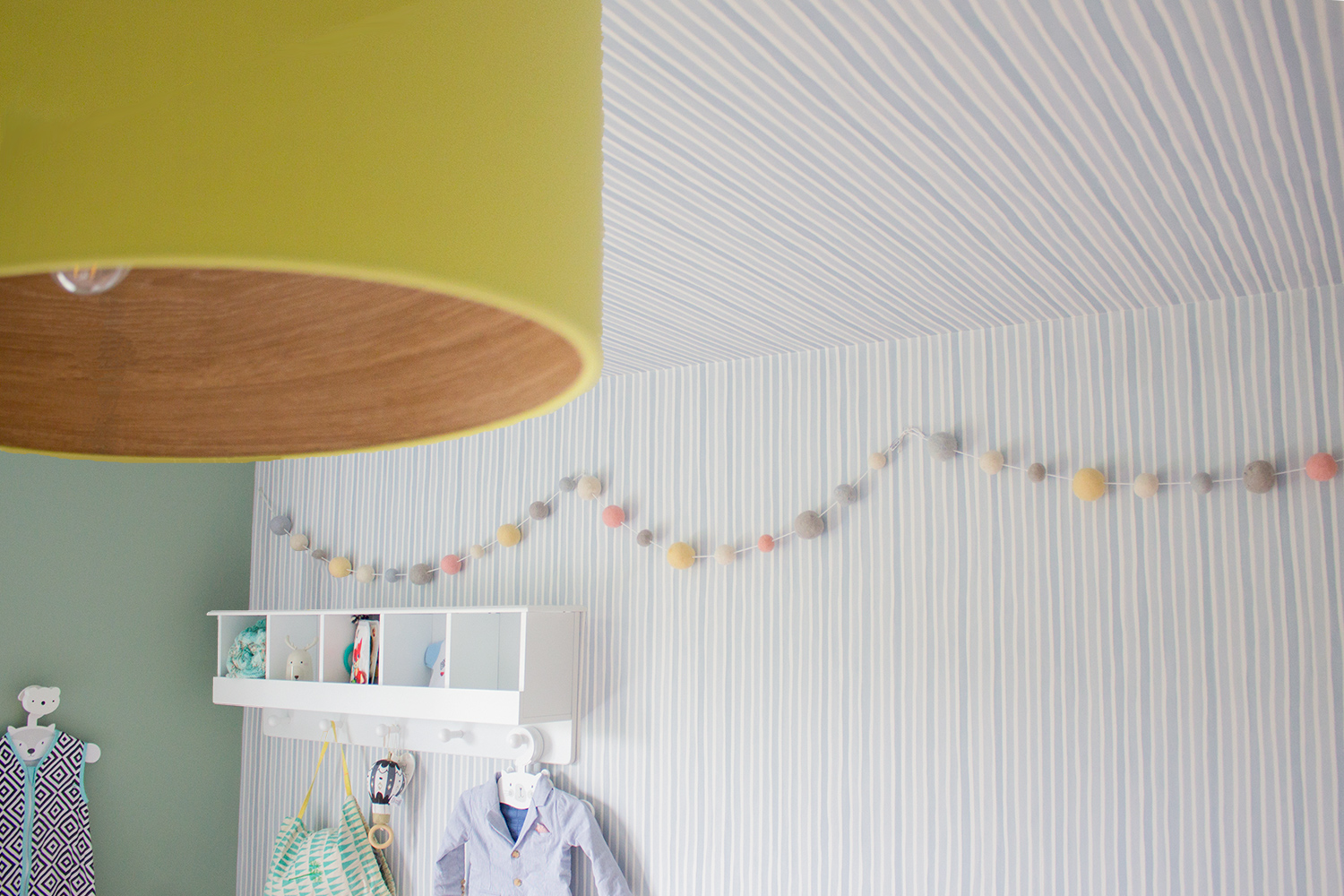A photo of the subtly stripe wallpaper on the ceiling