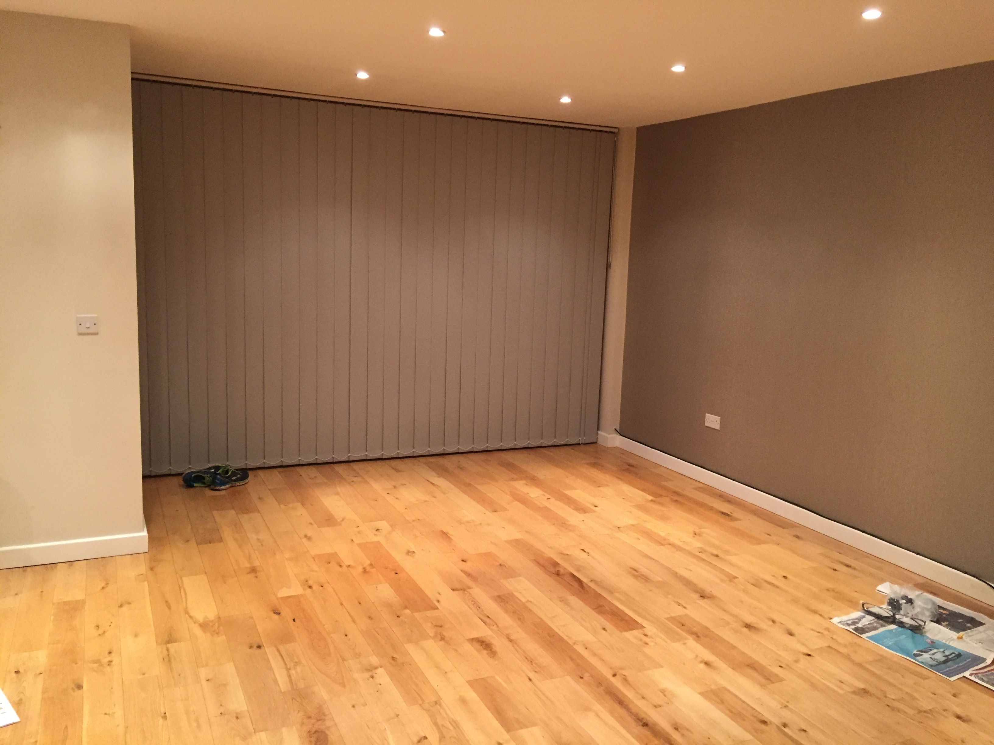 A photo of the client's living room which is fairly bare and uninviting