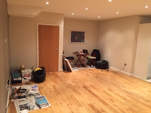 A photo of the client's living room just after they moved in