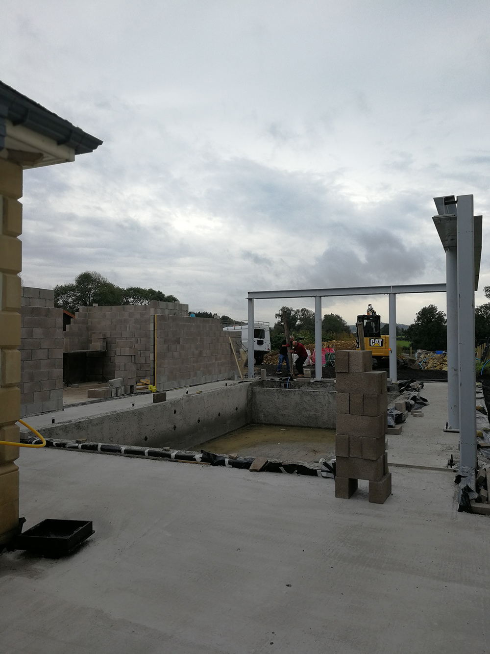 A photo of the pool area being dug up, with the build underway.