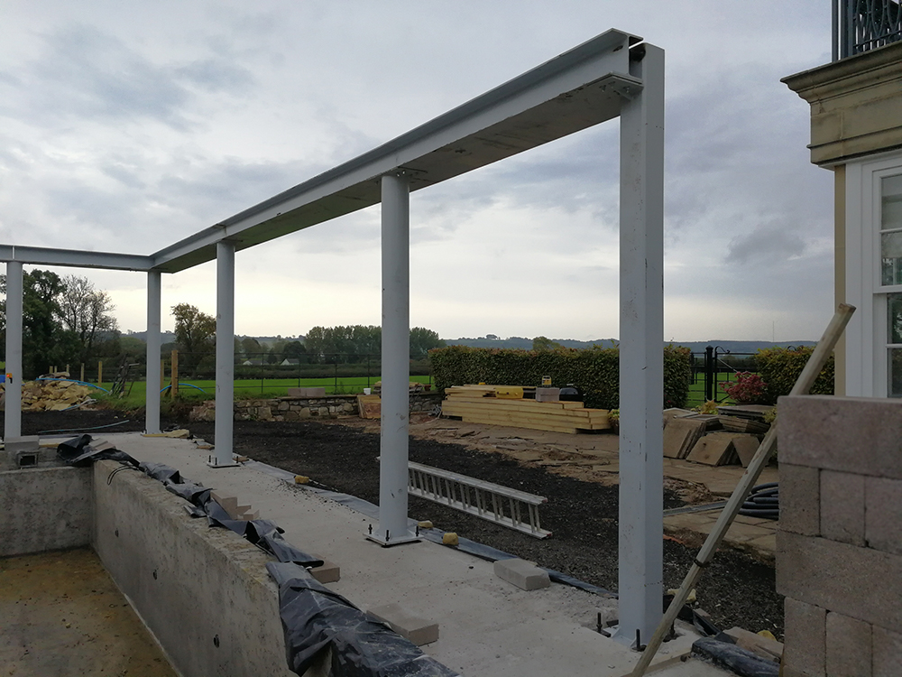 A photo of the structure which will hold up the pool roof.