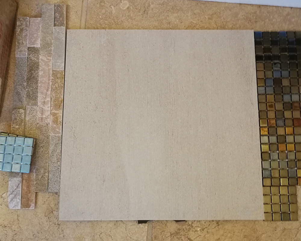 The replacement floor tiles we chose for around the pool.