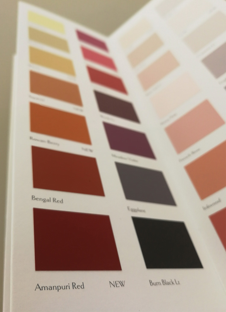A picture of the page in the Sanderson colour card containing Amanpuri Red.