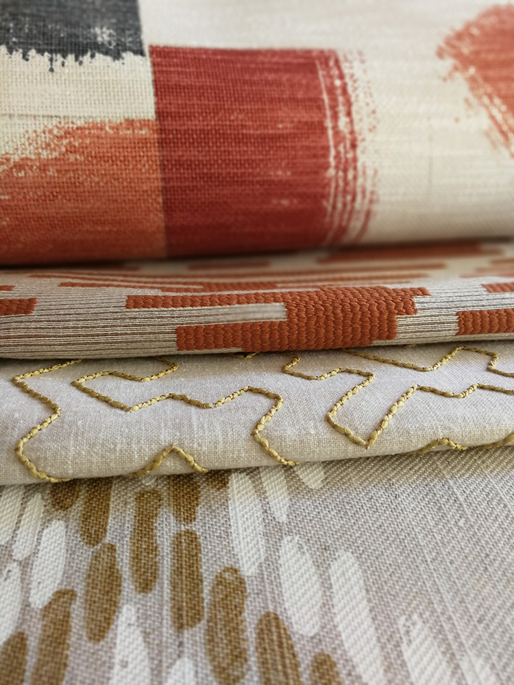 a photo of some fabrics in Autumnal colours from the Villa Nova collection called Huari