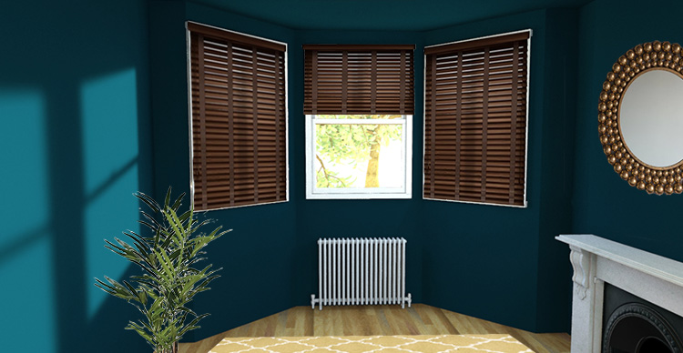 A picture of a bay window with wooden Venetian blinds at each window