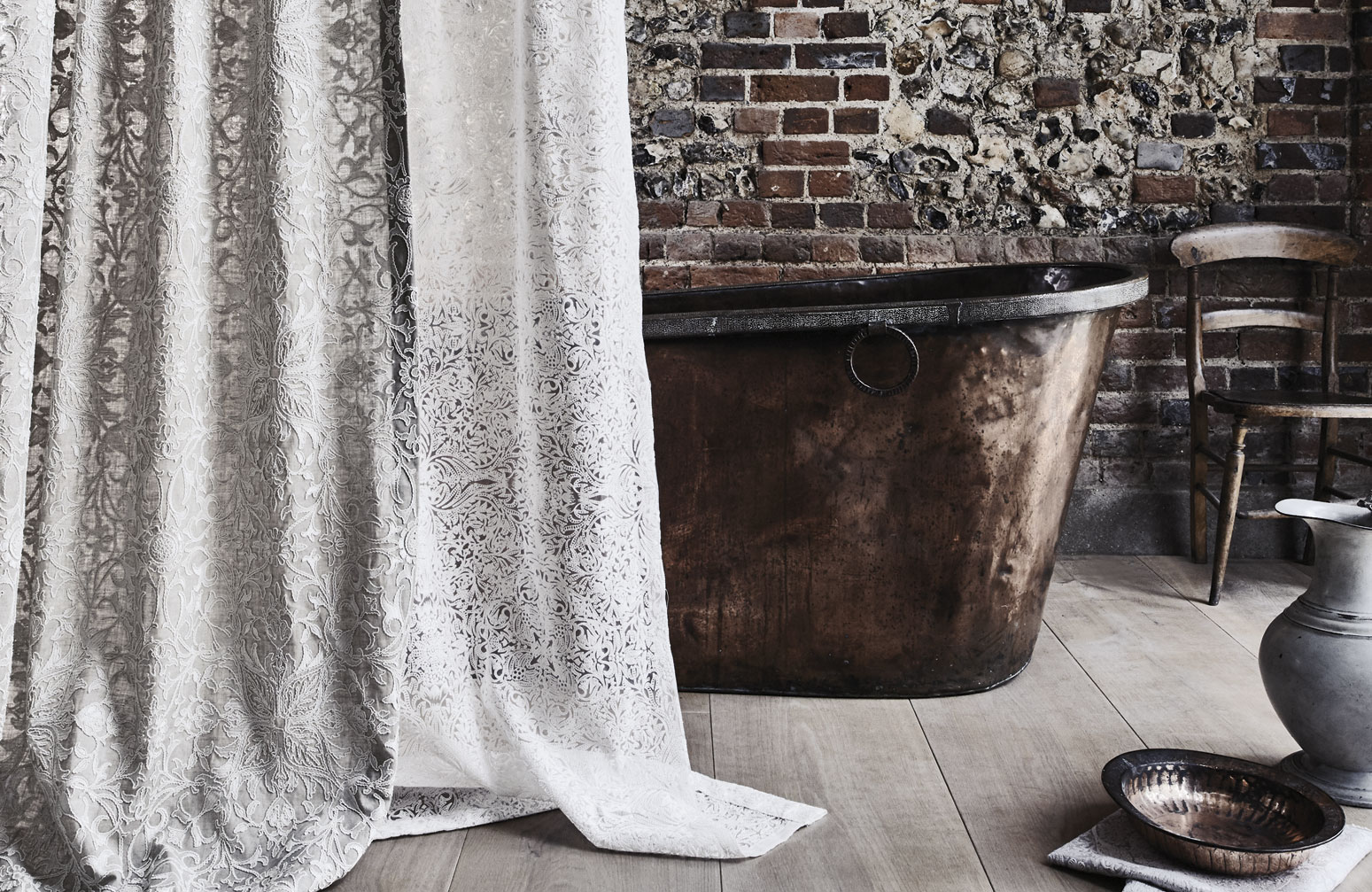 a sheer curtain fabric from the Pure Collection, hanging in front of a copper bath