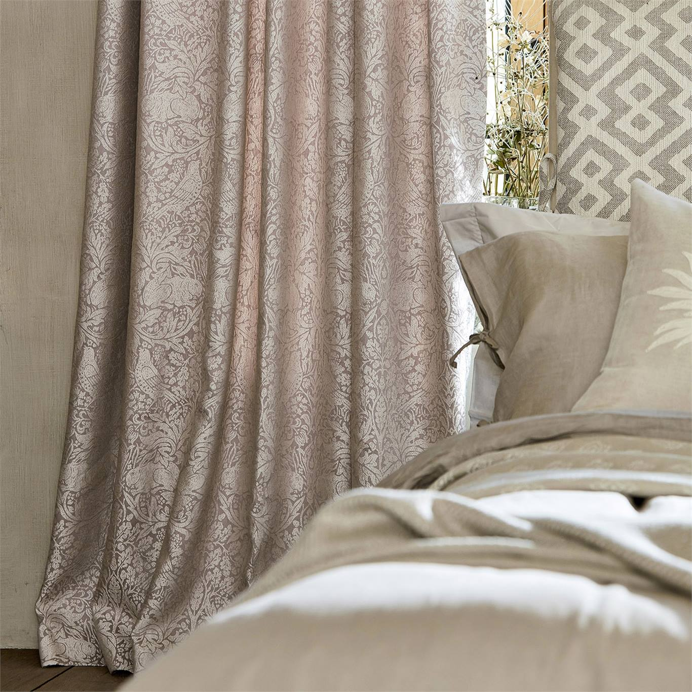 'Pure Brer Rabbit' in soft pink, as curtains behind a bed