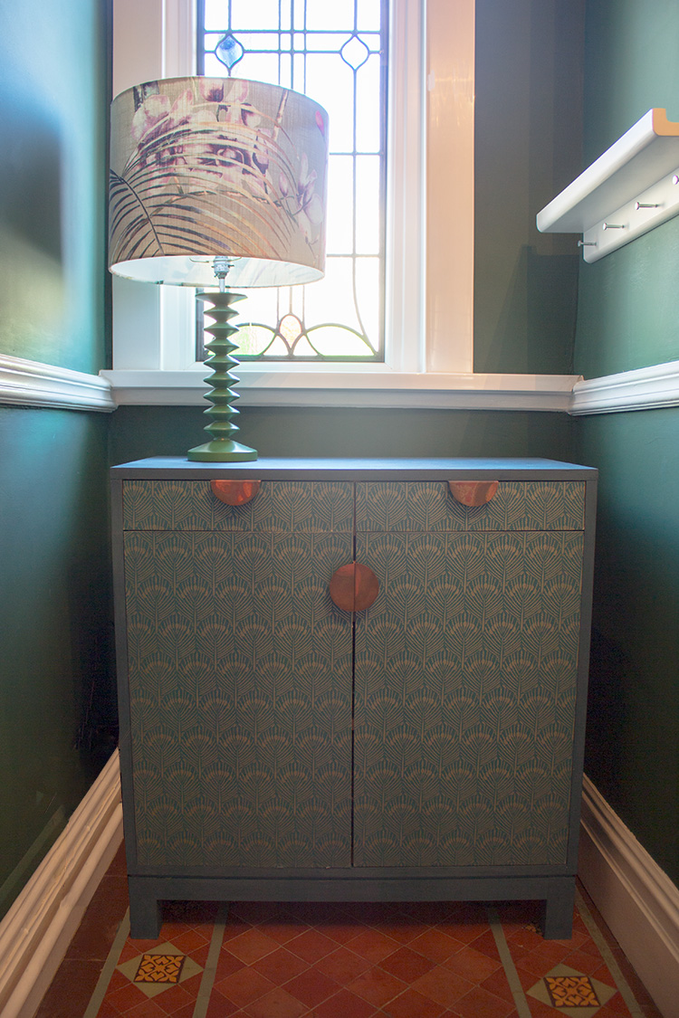 A photo of my painted and wallpapered hallway cupboard.