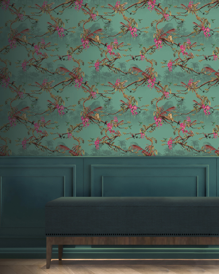 A tropical teal wallpaper plasters the wall above a wainscoting panelling and a navy fabric covered bench. The wallpaper is adorned with tropical wildlife and atmospheric jungle scenery including parrots and  jaguars.