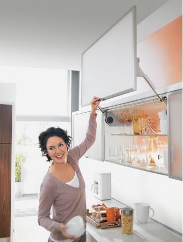 A photo from a kitchen brochure showing the hinges in use on a cupboard.