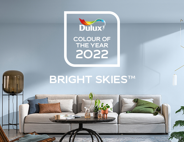 A promotional photo from Dulux showing the paint colour Bright Skies in a room setting.