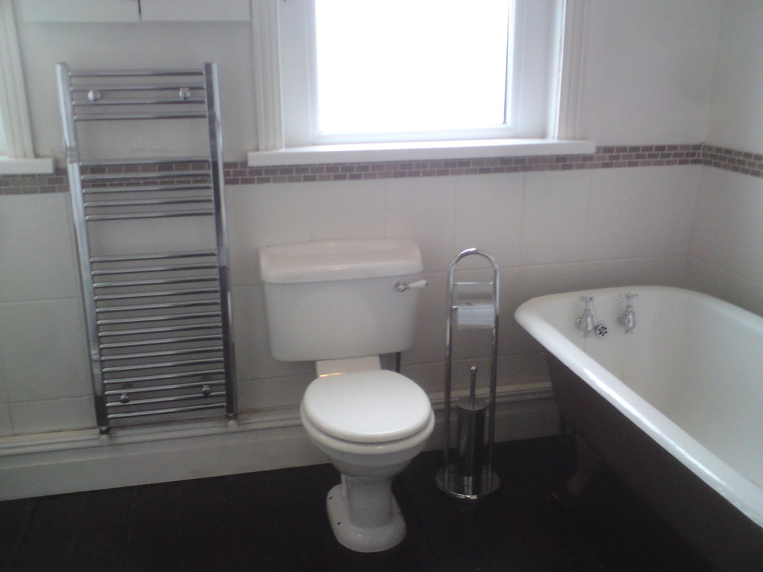 The same view with the old loo with the towel radiator next to it.
