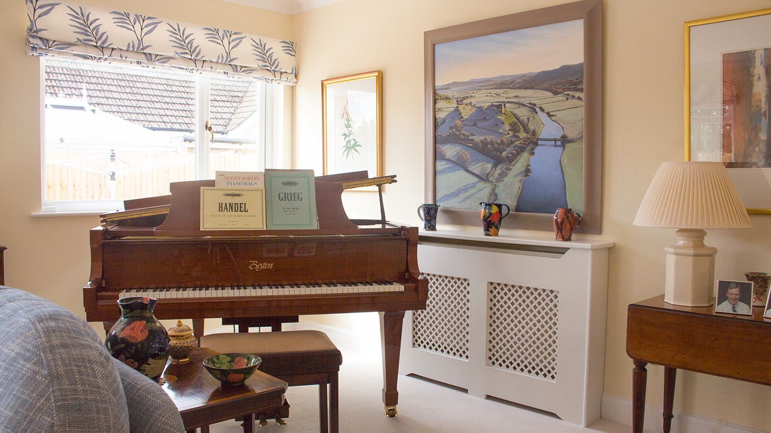 The new Roman blind, and the piano placed in front of the window.