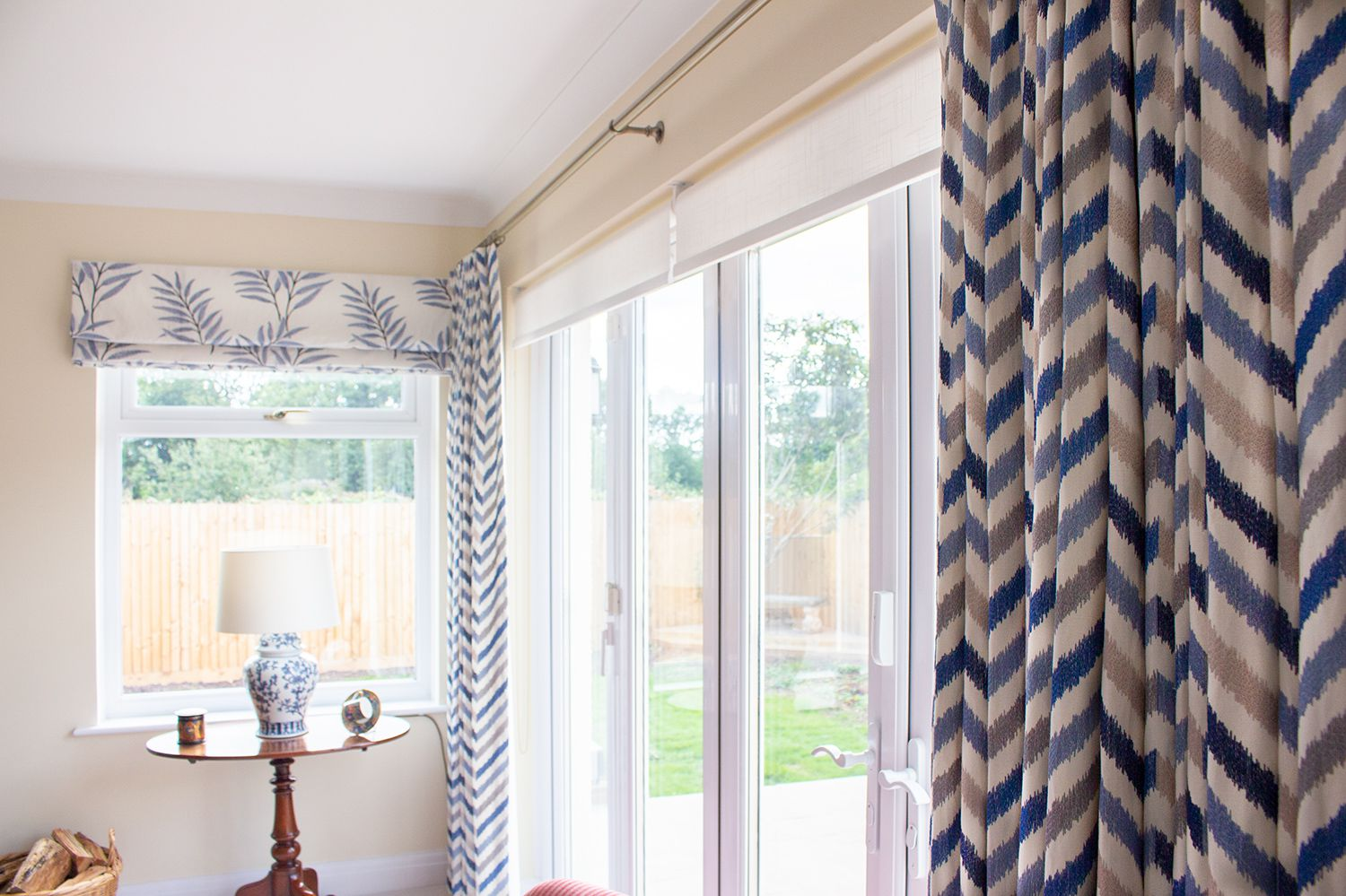 A view of the new blue patterned curtains and Roman blind in a coordinating fabric.