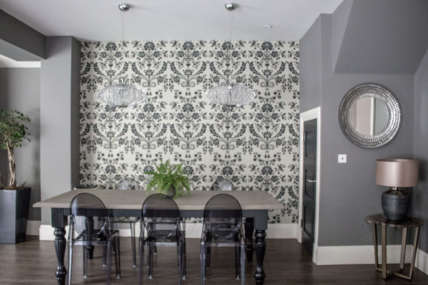 A photo of the new table and chairs in front of the glamorous black and white wallpaper.