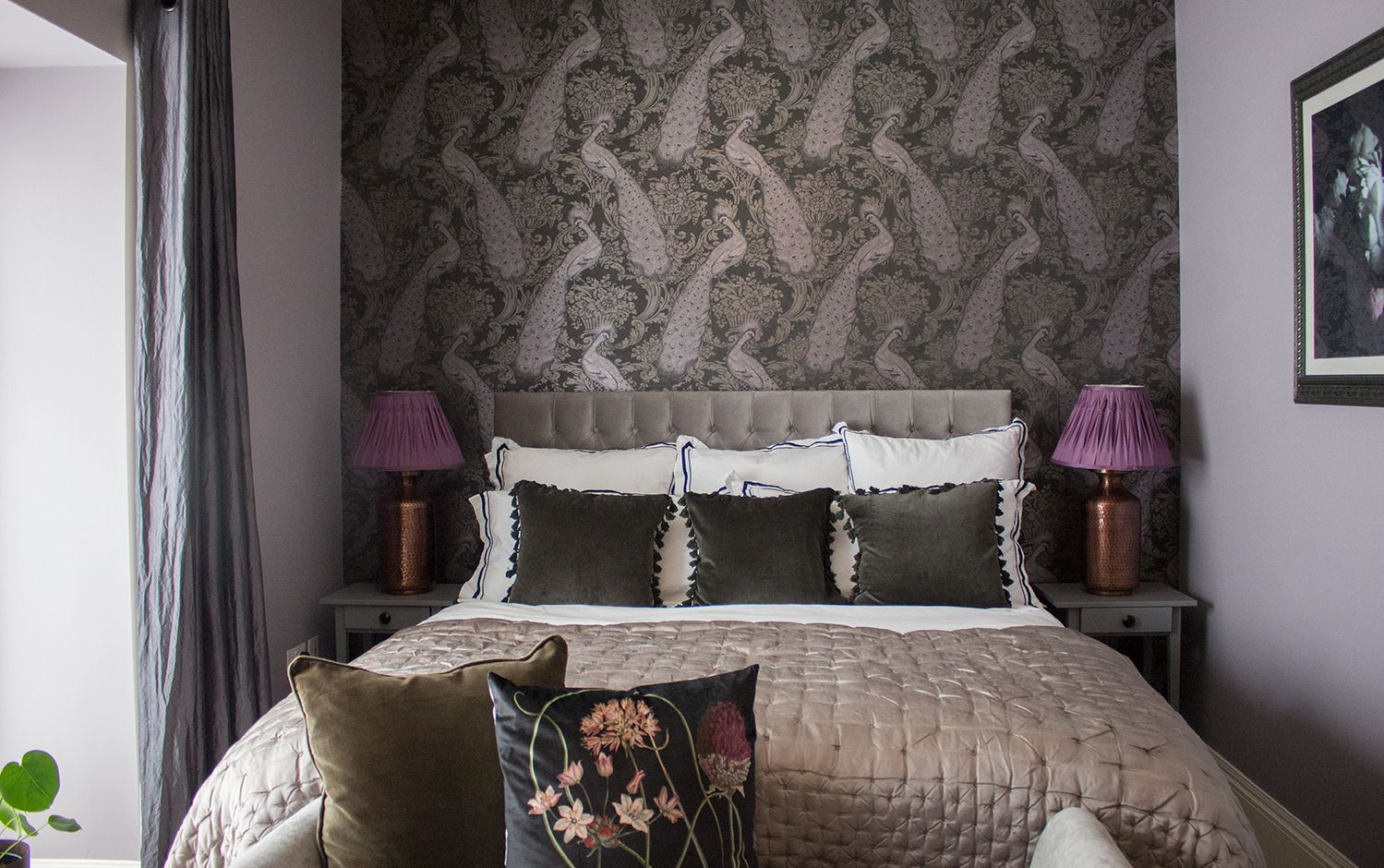 A photo of the bed with new headboard, statement wallpaper and luxury bedding.