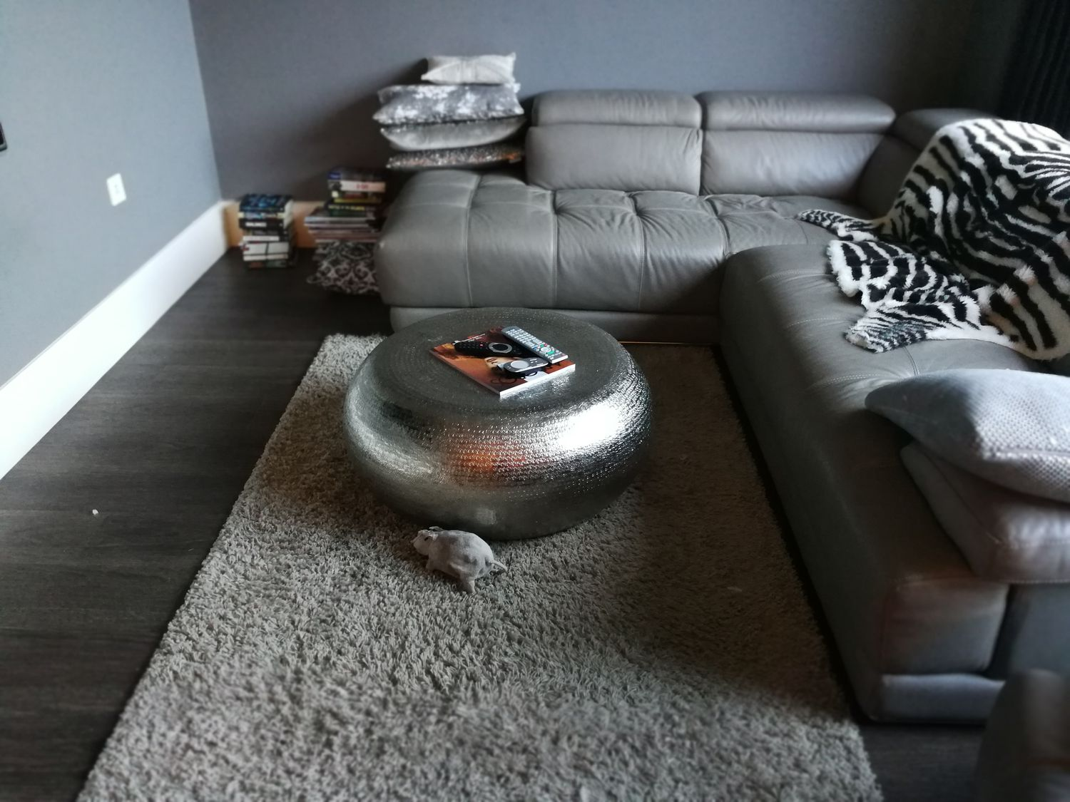 A photo of the same sofa and coffee table, with no mirror, cushions, rug or throws.