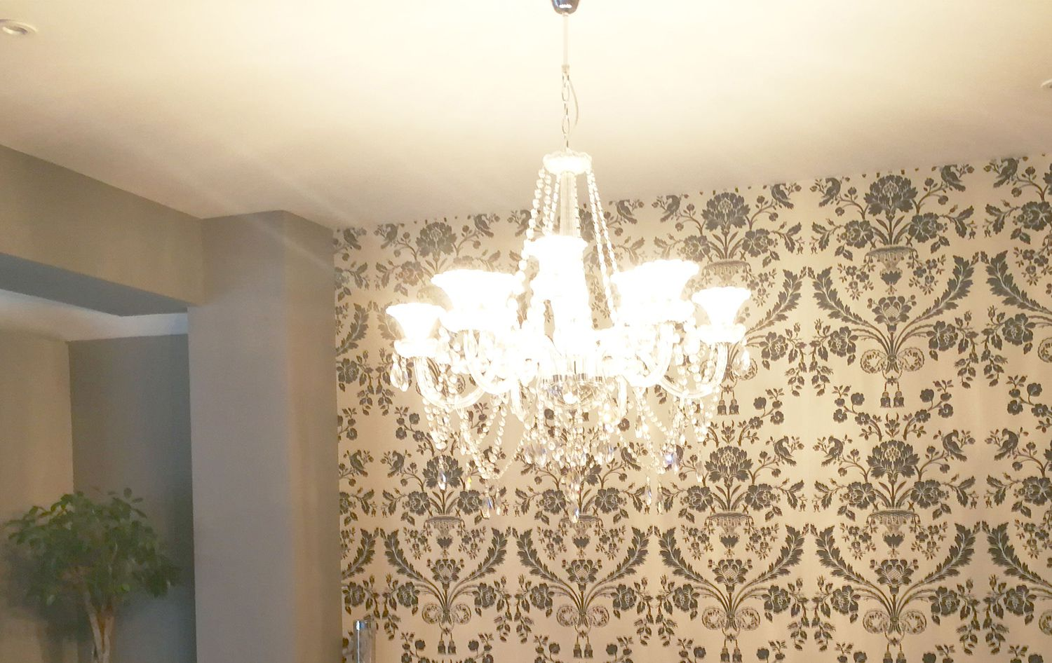 Before, there was one large glass beaded chandelier which wasn't in proportion to the space or the dining table.