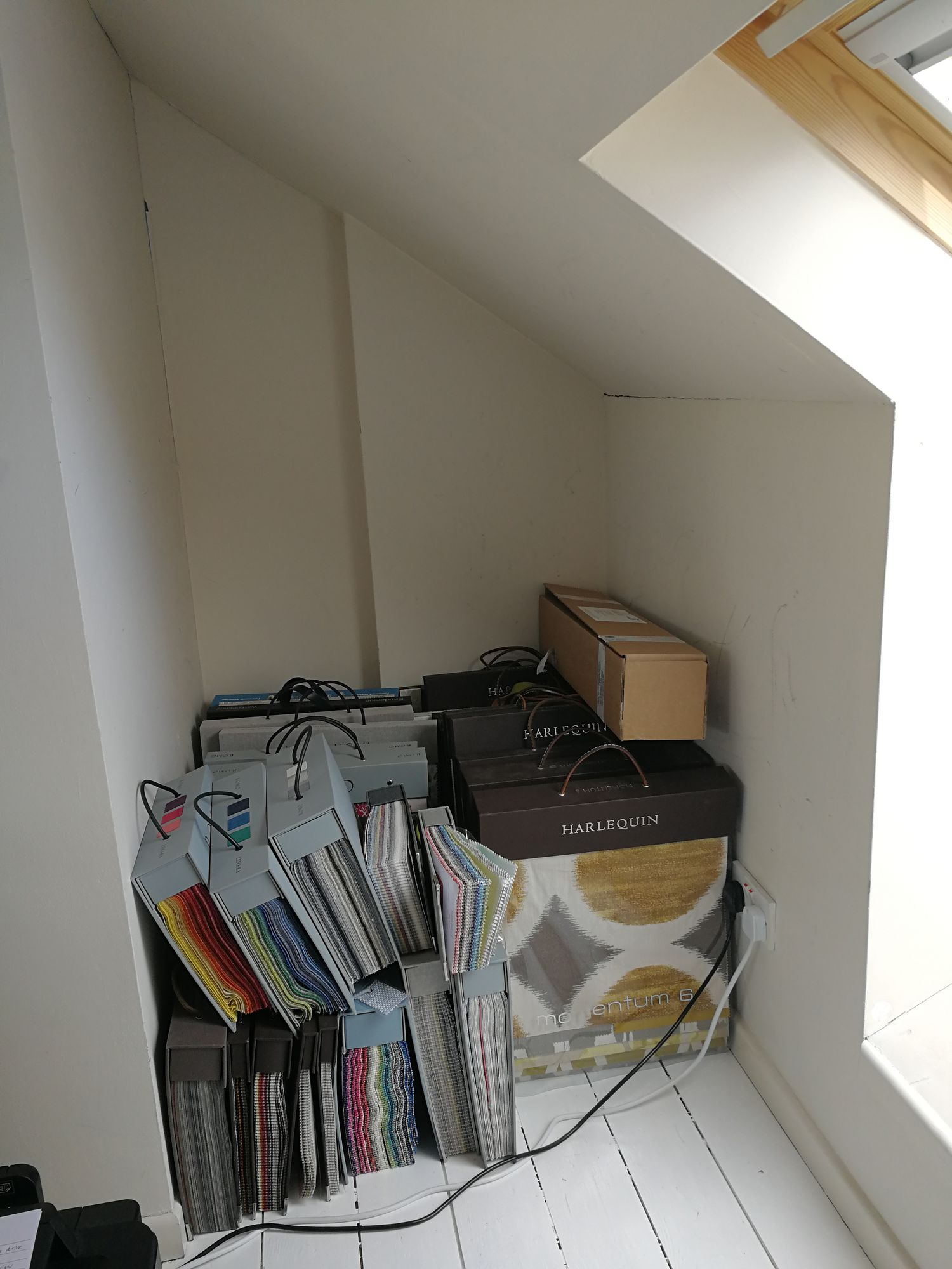 There was no shelving here before, so the fabrics books are stored on the floor.
