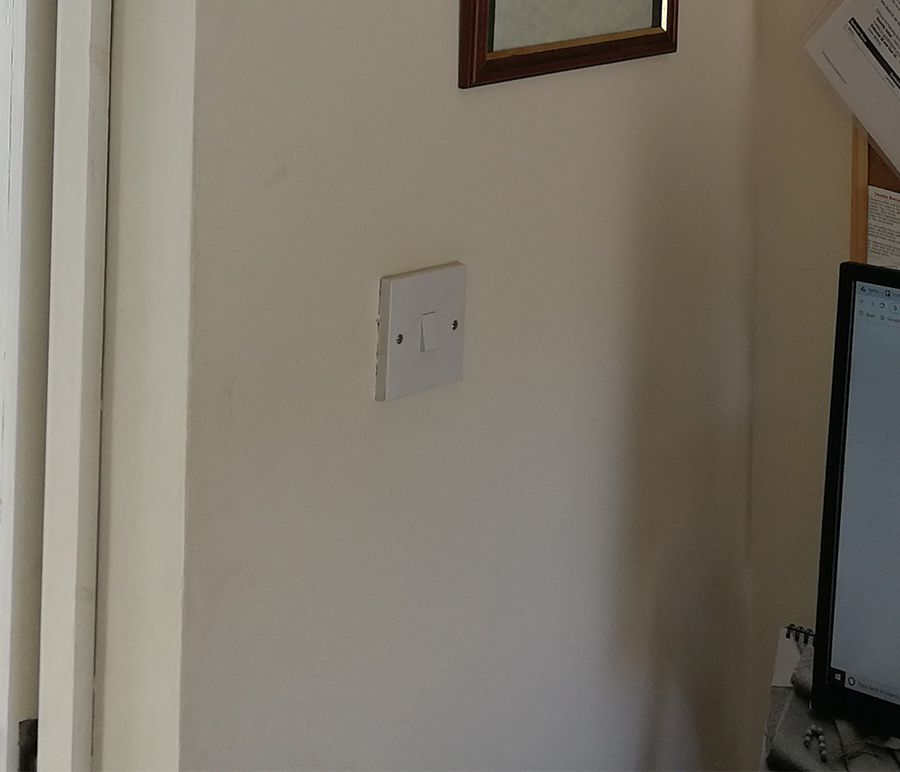 The previous light switch was a standard white one.