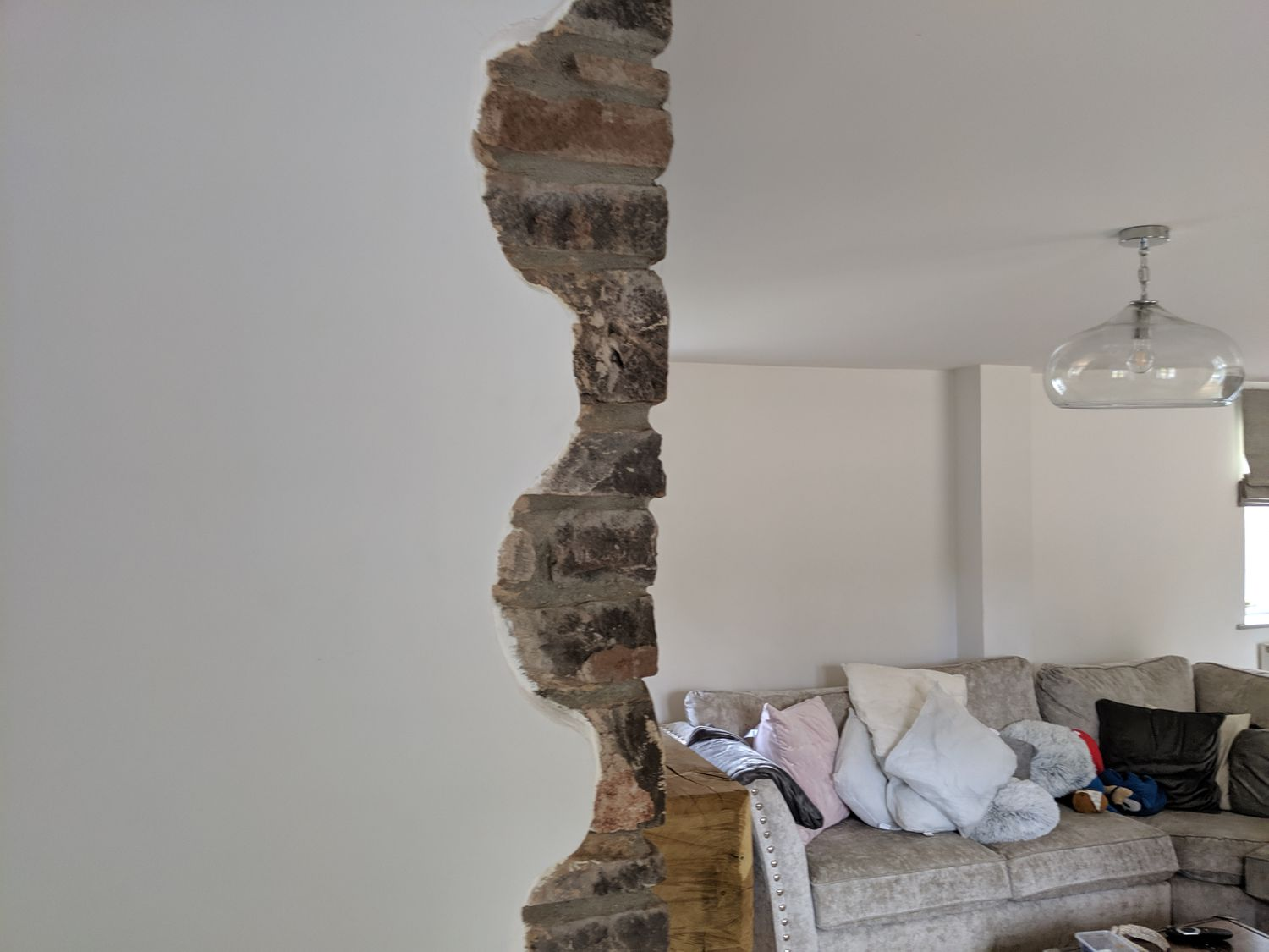 The same view of the chimney before it was taken out to make room for the seating.