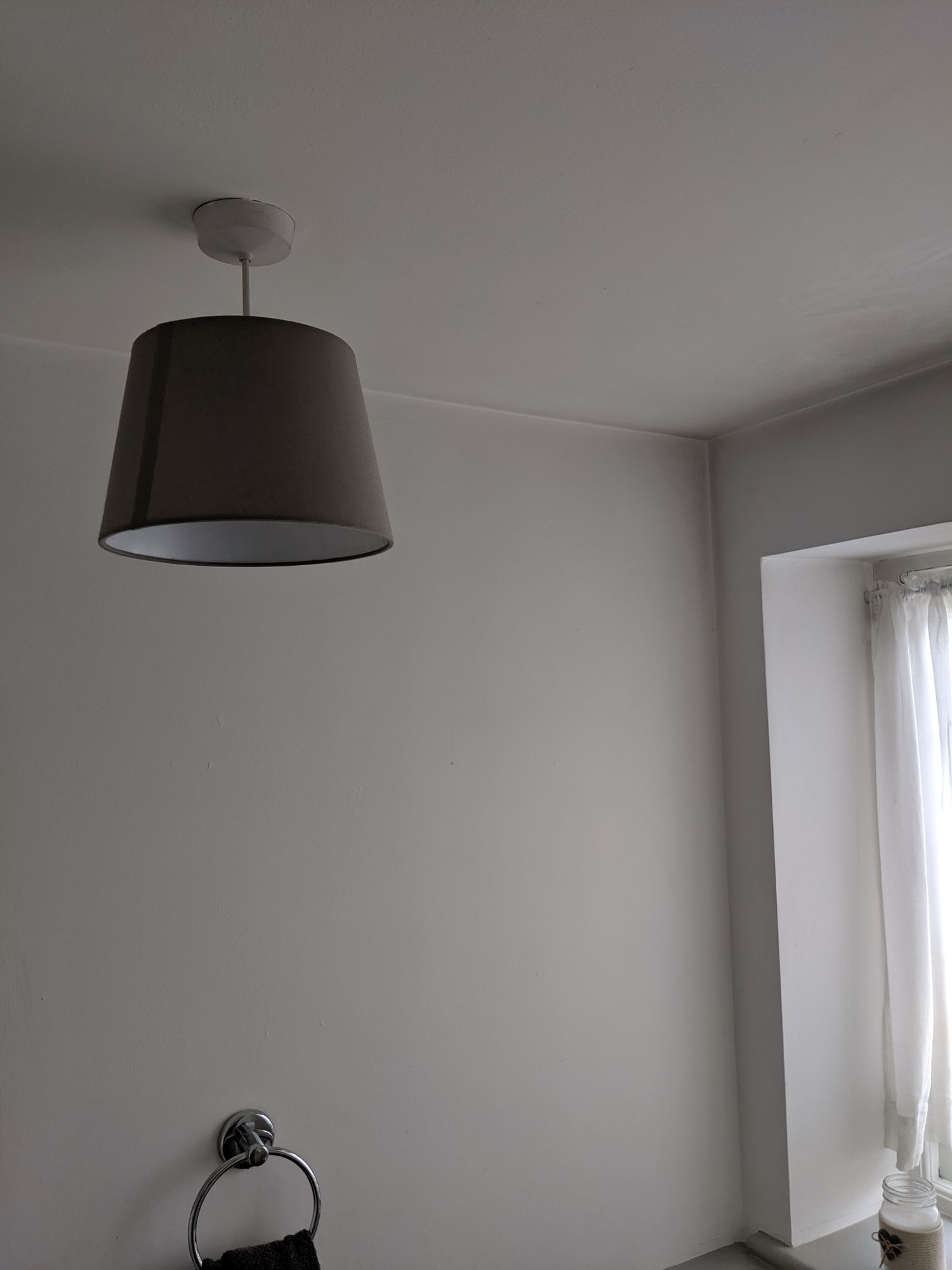 A photo of the old grey lightshade in the downstairs loo.