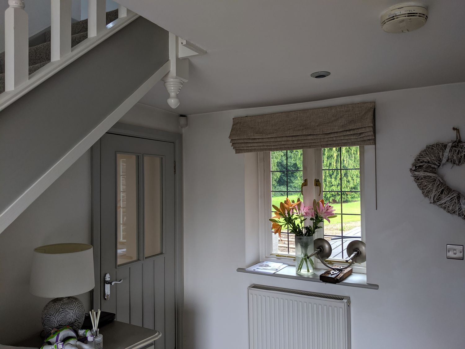 The same view of the hallway before, which was painted grey and white.