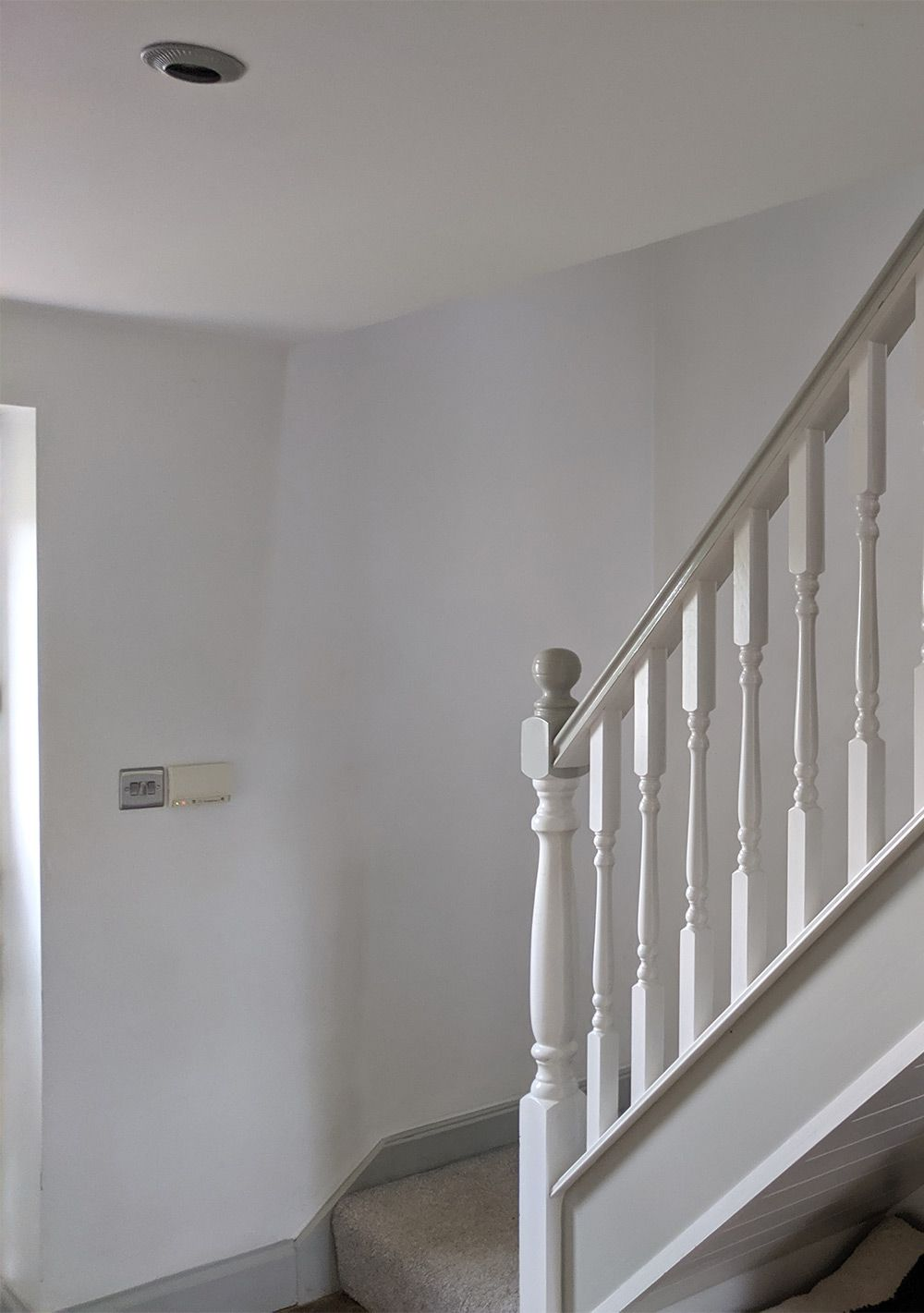 The area was bare before with white painted walls and no decoration.
