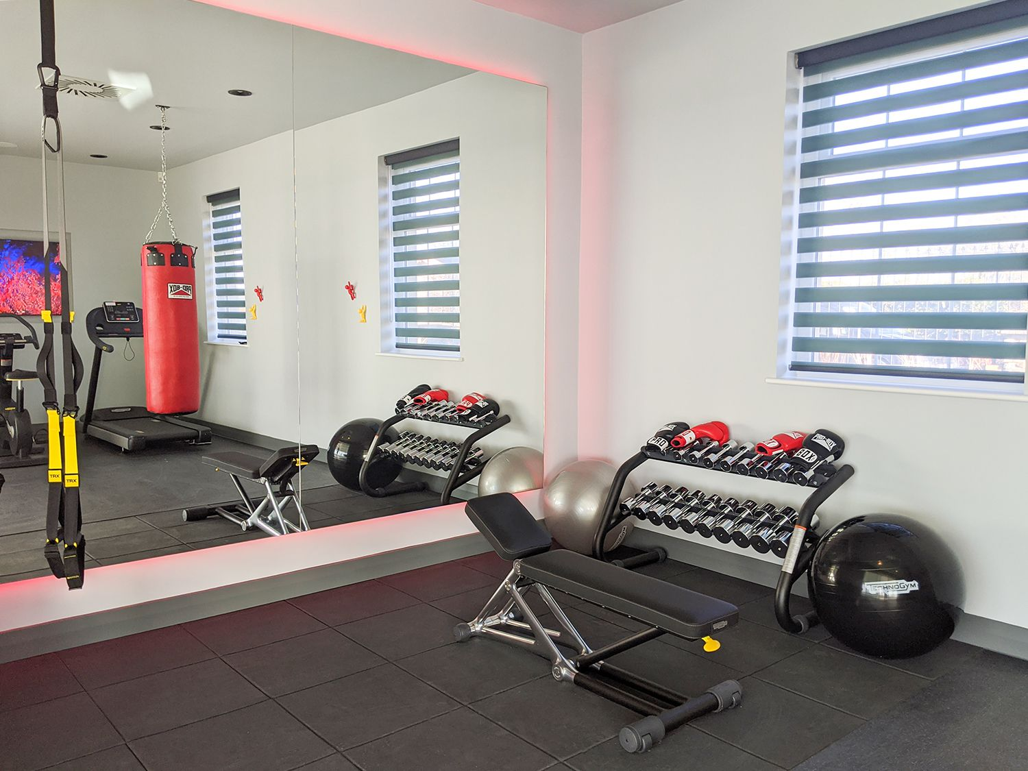A photo of the corner of the gym, showing the punchbag and some of the equipment.