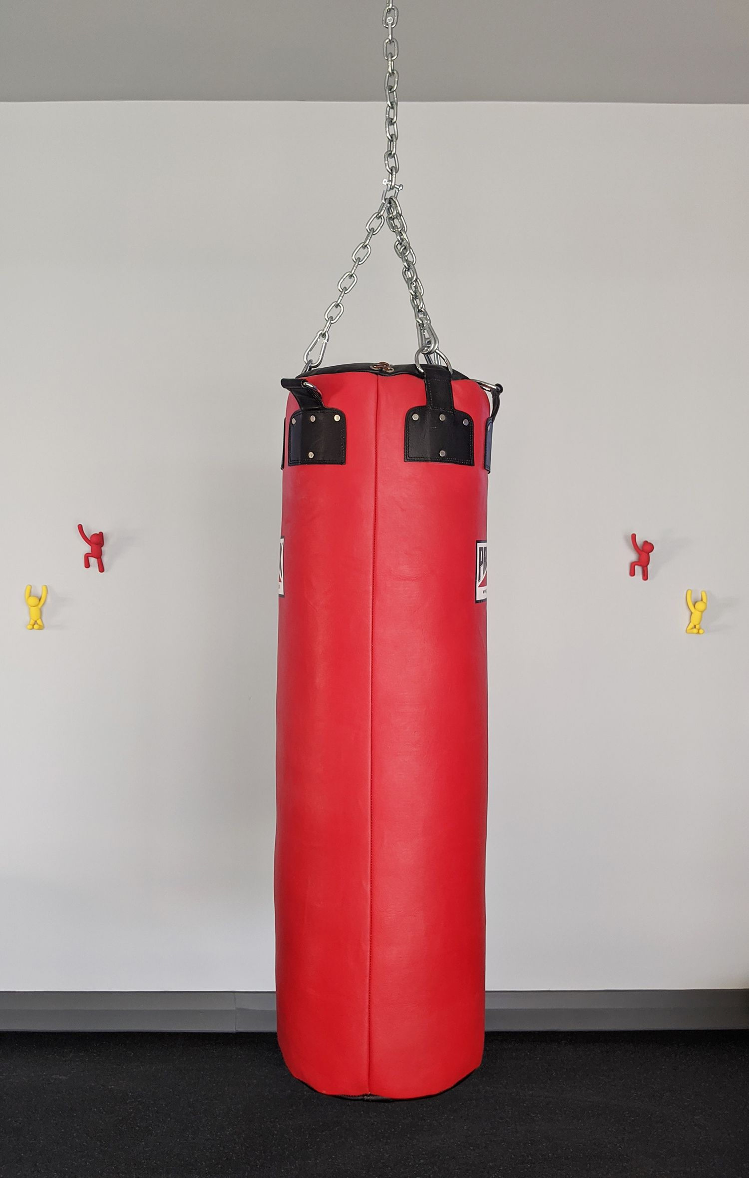 A close up of the red punch bag in the gym.