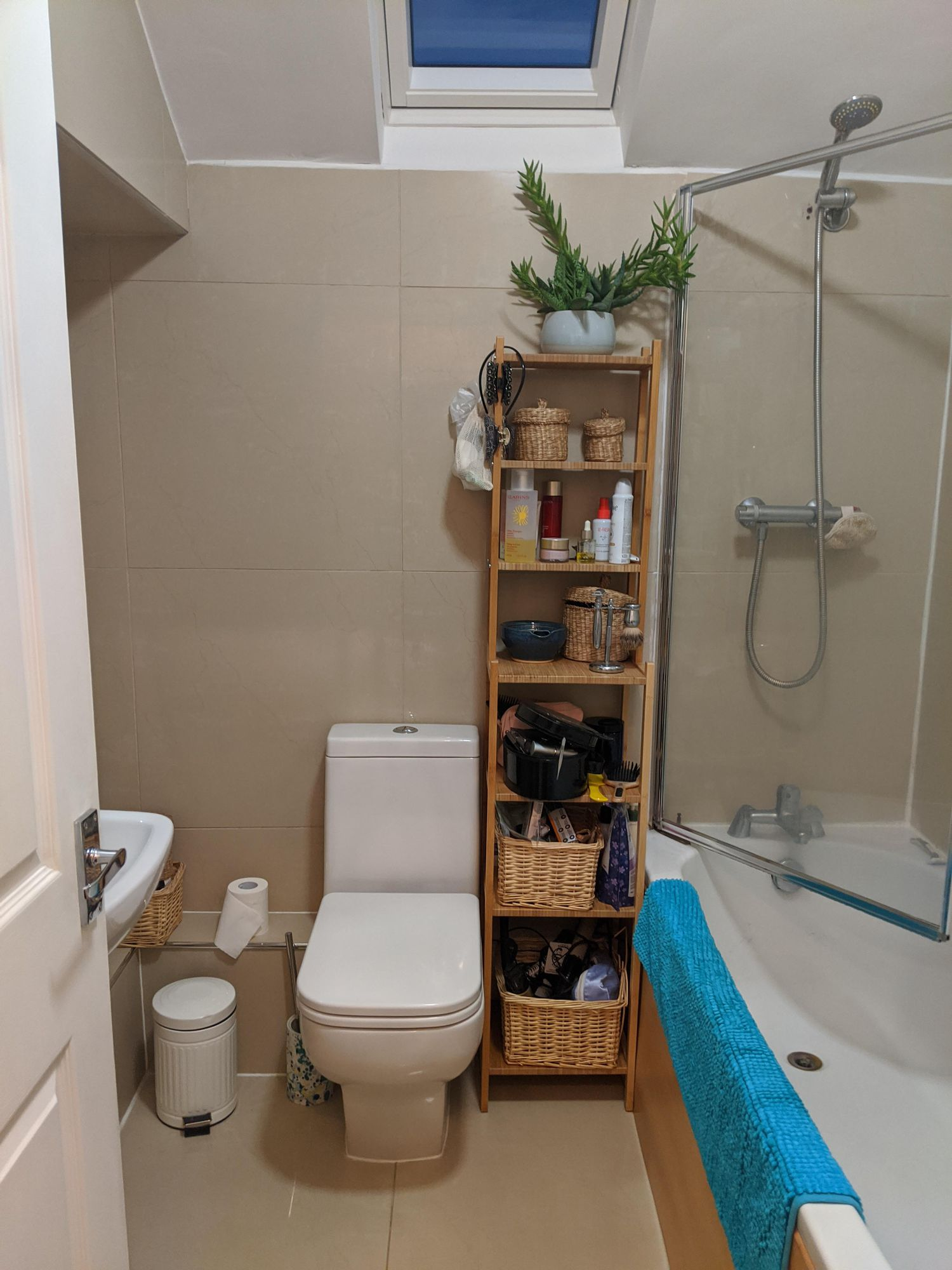 The same view before any work was done, showing the beige tiles and a lack of good storage.