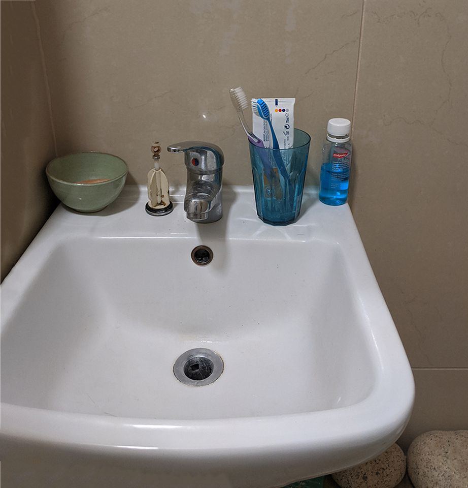 The sink before was overlarge and off centre.