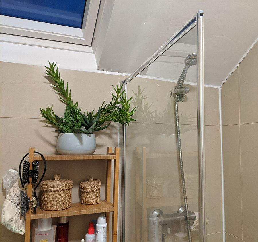 A photo showing the old open storage shelving, which was squeezed in between the bath and the loo.