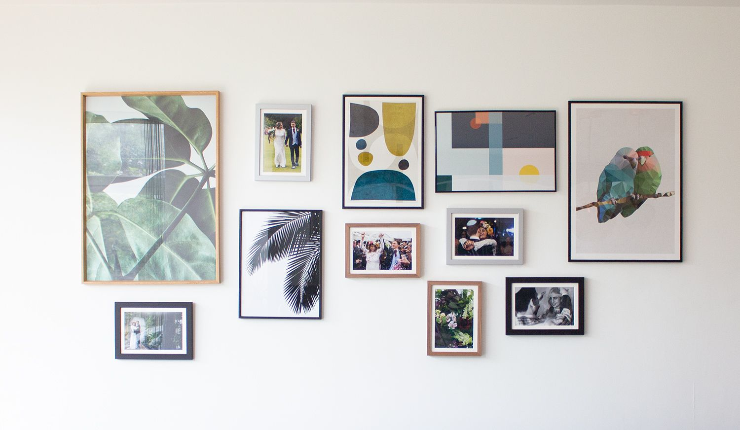 A photo of the gallery wall created from specially chosen artwork and personal photos.