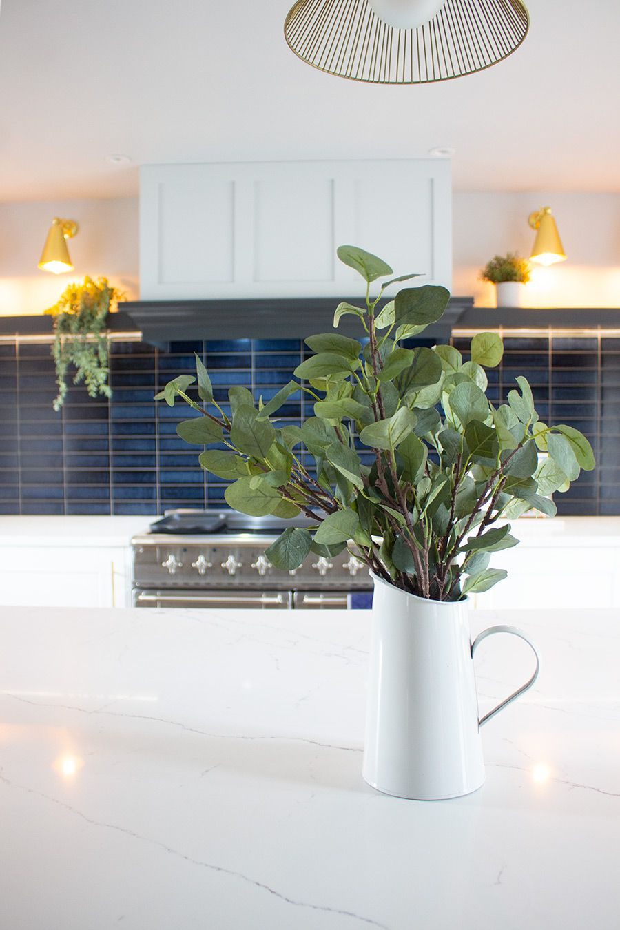 A photo of an enamel jug on the marble worktop.