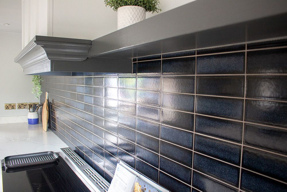 A close up of the navy tiles used as a splashback.
