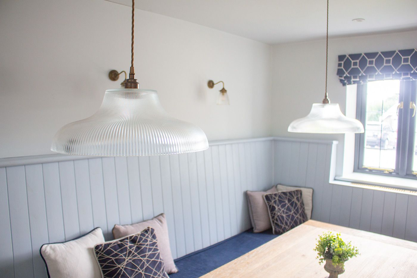 A photo of the two pendant lights over the dining table.