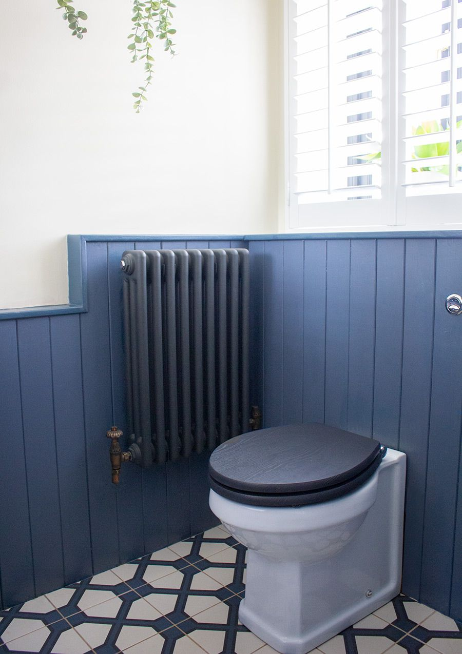 A photo of the blue and white tiles floor in the downstairs loo.