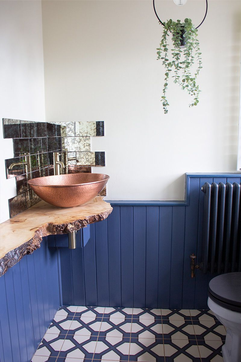 A photo of the new sink area, which has a hammered copper sink and living edge wood shelf for it to sit on.