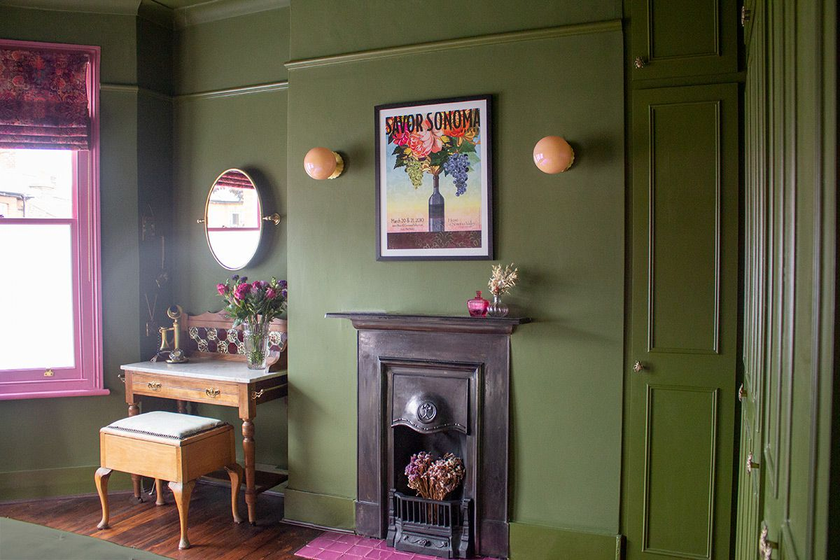 A photo of the original fireplace area, with the newly painted Bancha green walls.