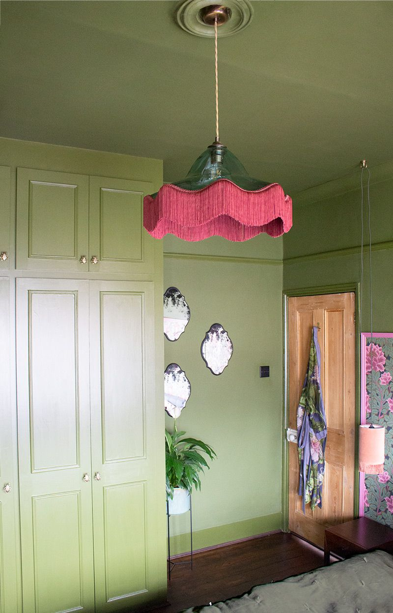 A photo of the the three antiqued mirrors by the green painted wardrobes.