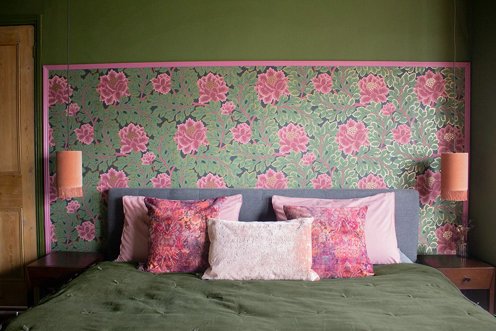 A photo of the wallpaper behind the headboard of the bed.