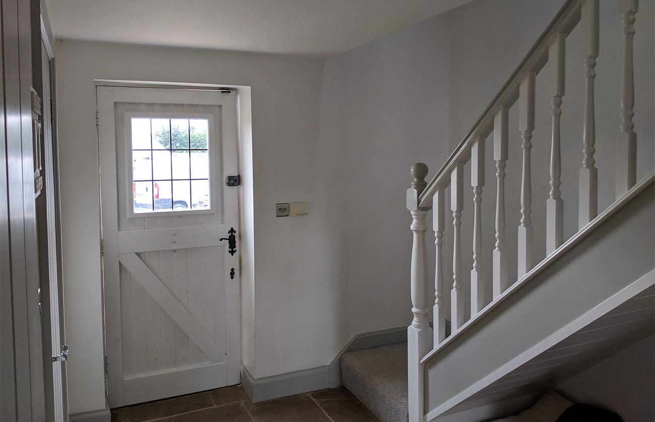 A photo of the hallway before, which was painted grey and white.