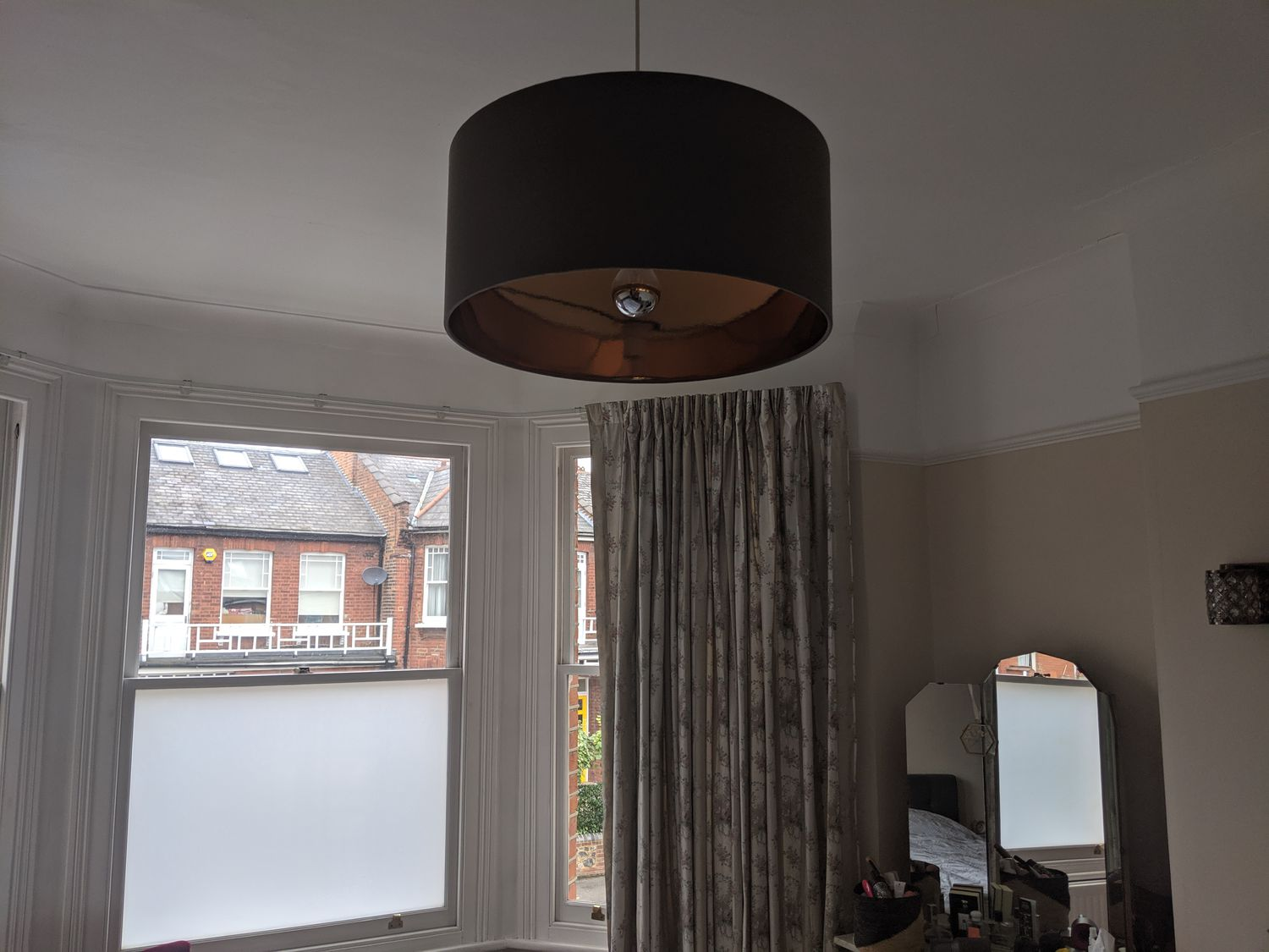 A photo of the dark grey plain lampshade which was there before the new one was installed.