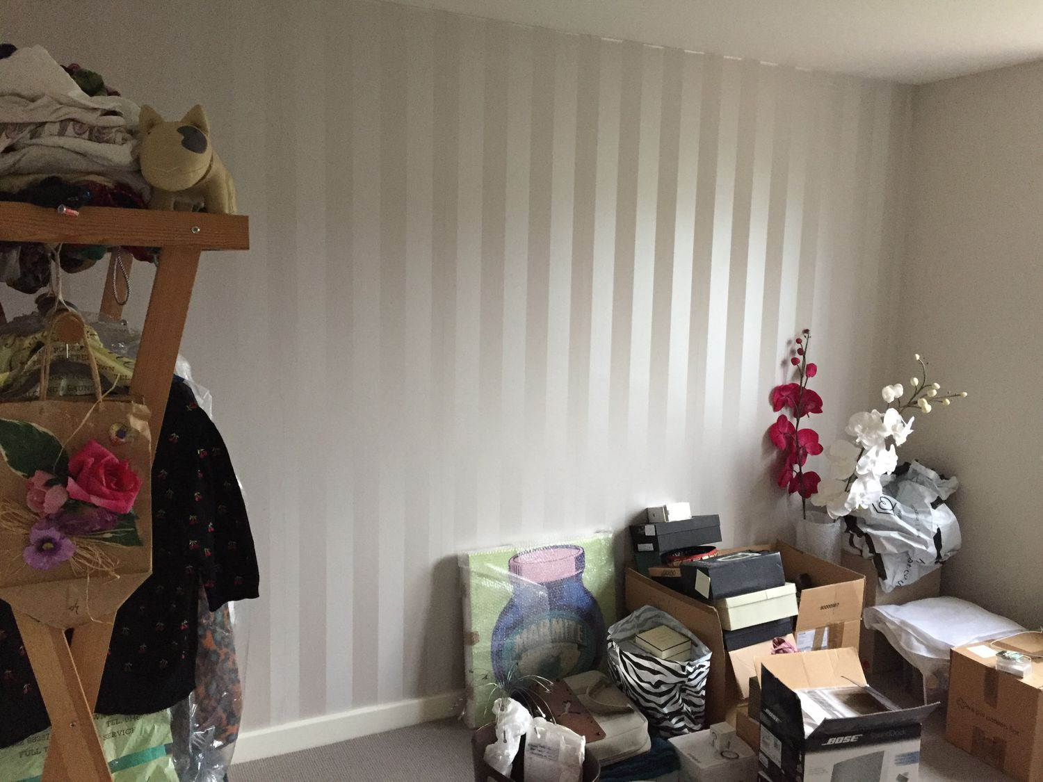 Before, this wall was wallpapered in a cream stripe wallpaper and the room was being used for storage.